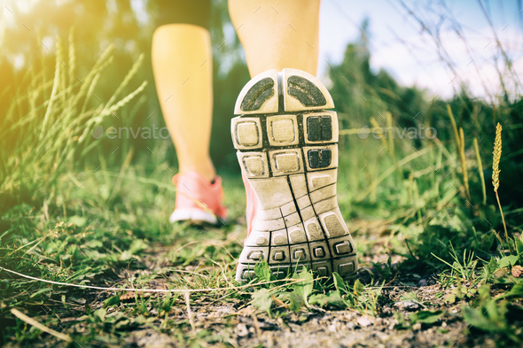 Walking or running legs in forest, adventure and exercising - Stock Photo - Images
