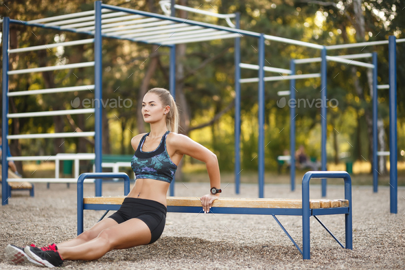 Woman doing dips workout - Stock Photo - Images