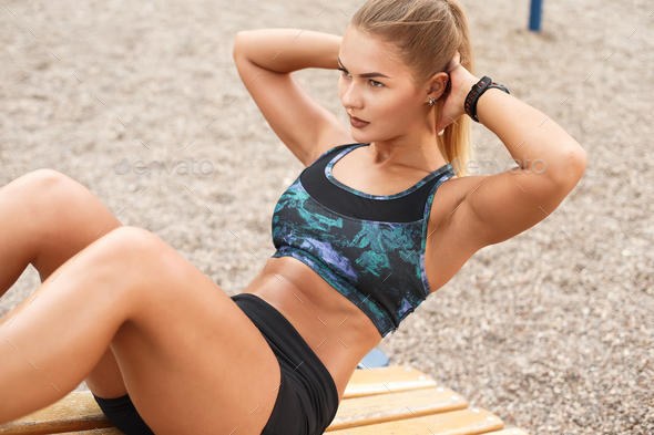 Woman outdoor workout sit ups - Stock Photo - Images
