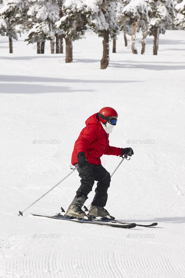 Skiing on a forest slope. White mountain landscape. Winter sport - Stock Photo - Images