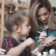A Little Girl Is Making a Clay Craft in a Pottery Workshop. Mom and Child Spend Time Together Doing - VideoHive Item for Sale