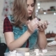 Young Woman Creates a Plate of Clay in the Workshop. Girl Holding a Shape of Clay in Her Hands - VideoHive Item for Sale