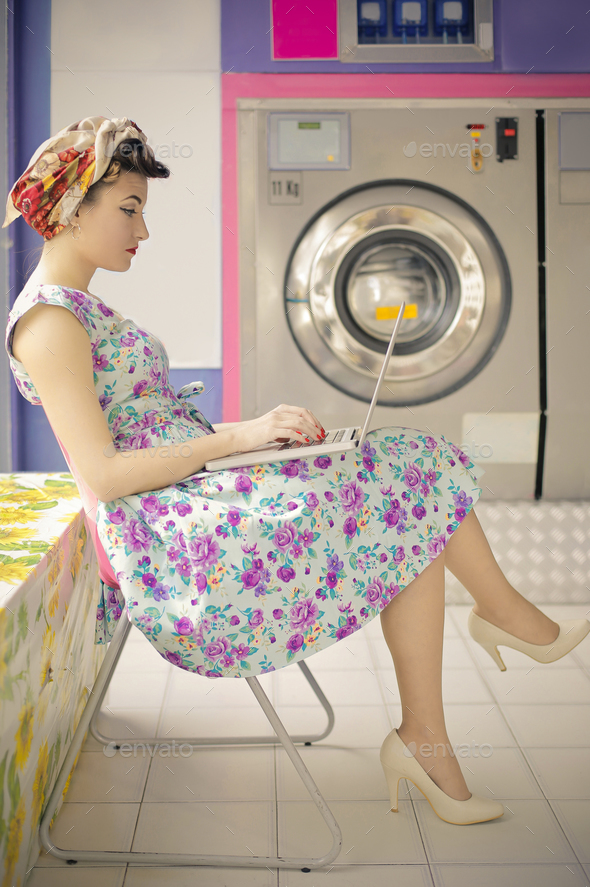 Girl at the laundromat - Stock Photo - Images