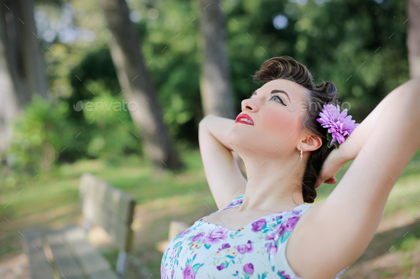 Girl relaxing at a park - Stock Photo - Images