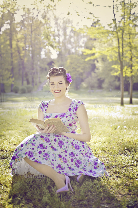 Girl reading in a park - Stock Photo - Images