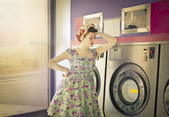 Woman at the laundromat - Stock Photo - Images