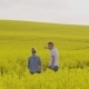 Farmers Discussing at Rapeseed Field - VideoHive Item for Sale