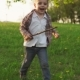 Happy Little Boy Running on Grass in Sunny Summer Park - VideoHive Item for Sale