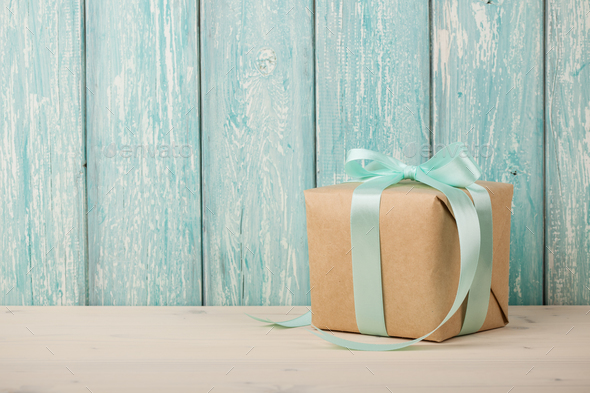 Gift box on wooden table - Stock Photo - Images