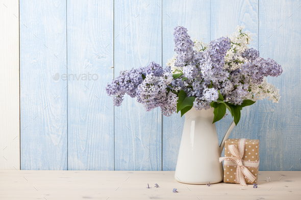 Lilac flowers in jug and gift box - Stock Photo - Images