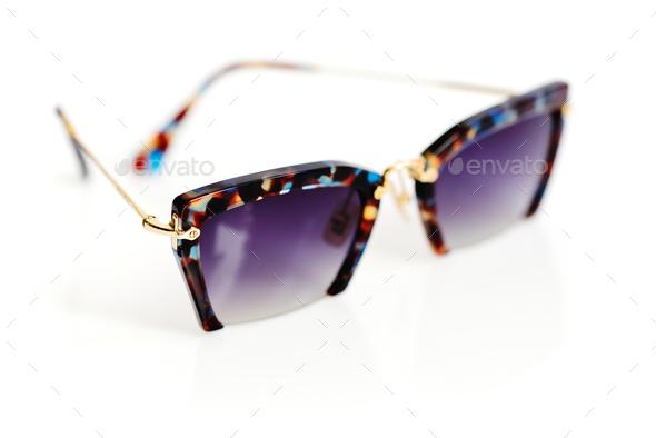 Stylish women's sunglasses on white background - Stock Photo - Images
