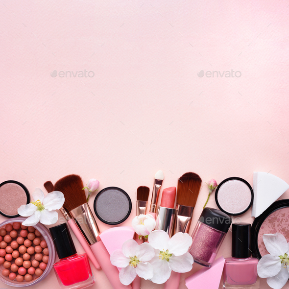 Makeup brush and decorative cosmetics with apple blossom on a pa - Stock Photo - Images