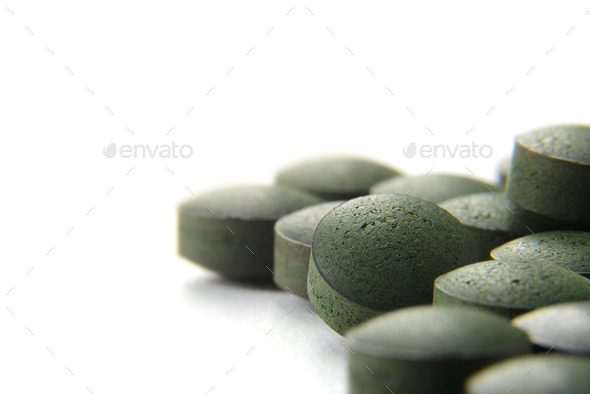 Pure Organic Spirulina Tablets Over white Background - Stock Photo - Images