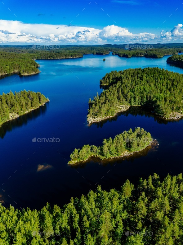 Aerial view of blue lake and green forest. Beautiful summer landscape in Finland. - Stock Photo - Images