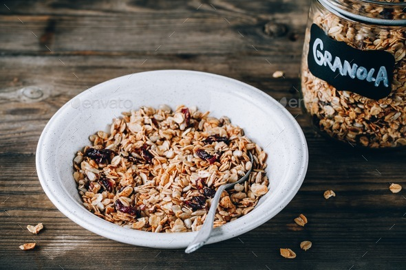 Organic homemade granola cereal with oats and nuts and dry cranberries. - Stock Photo - Images