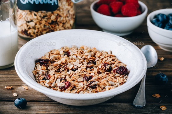 Homemade granola cereal with oats and nuts and dry cranberries - Stock Photo - Images