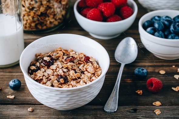 Homemade granola cereal with oats and nuts and dry cranberries.  - Stock Photo - Images