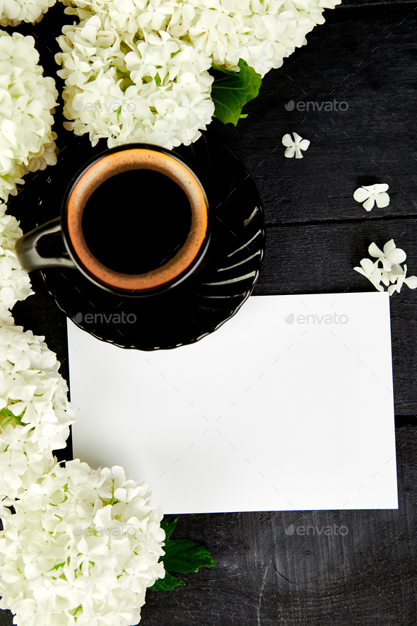 Cup of coffee with bouquet hydrangea - Stock Photo - Images