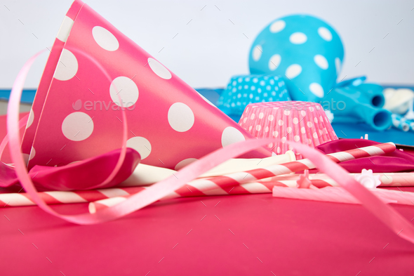 Party pink and blue paper hat. - Stock Photo - Images