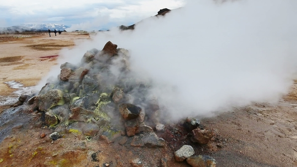 Eruption of Geyser in Iceland. Red Soil, Like the Surface of the Planet Mars