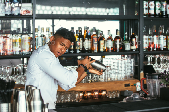 Expert barman shakes a cocktail - Stock Photo - Images