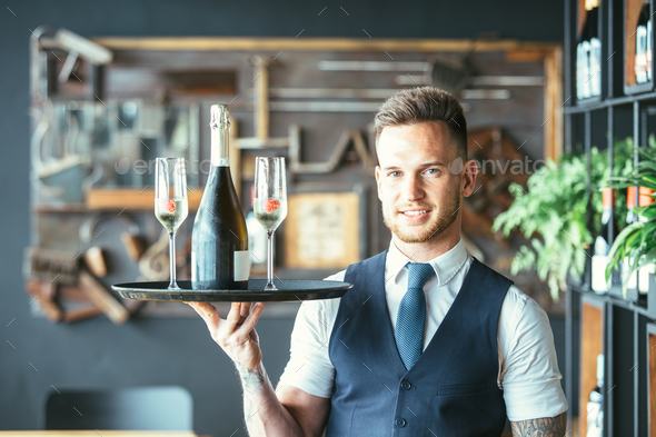 Smiling waiter with glasses - Stock Photo - Images