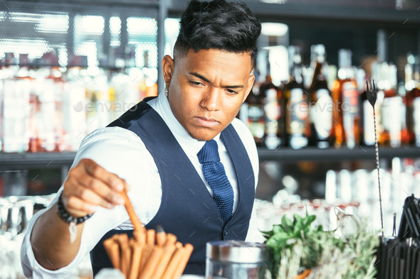 Expert barman taking cinnamon stick - Stock Photo - Images
