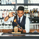 Concentrated expert bartender uses a blowtorch for a cocktail - PhotoDune Item for Sale