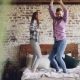 Young Beautiful and Loving Couple Dancing Having Fun and Laughing in Bed at Home. Carelessness - VideoHive Item for Sale