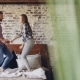 of Happy Young Lovers Dancing on Double Bed Having Fun in Bedroom and Laughing Carelessly. Cheerful - VideoHive Item for Sale