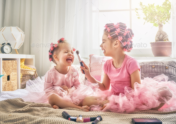 sisters are doing hair and having fun - Stock Photo - Images