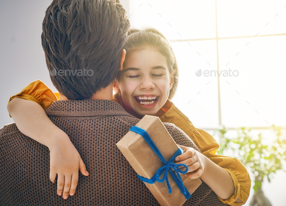daughter congratulating dad - Stock Photo - Images