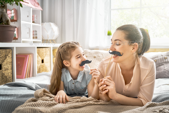 mother and daughter playing - Stock Photo - Images
