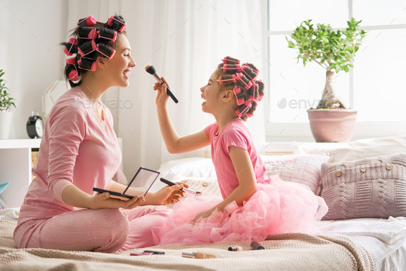 Mom and child doing makeup - Stock Photo - Images