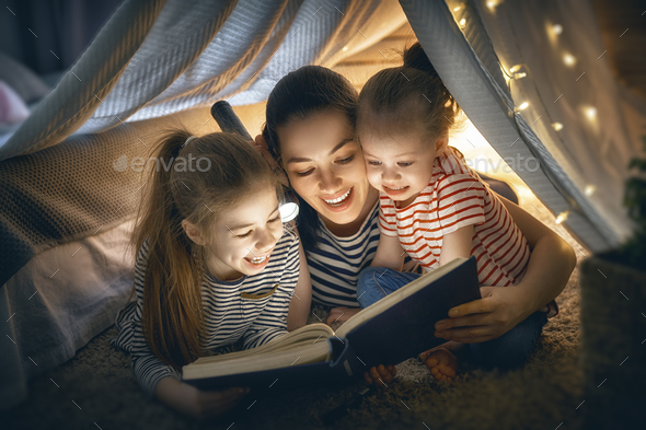 Mom and children reading book - Stock Photo - Images