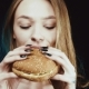The Hamburger Is in the Hands of the Girl. Delicious Fast Food. The Cheeseburger Smells. The Thin - VideoHive Item for Sale