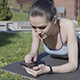 Woman Using Smartphone to Find new Fitness Exercises - VideoHive Item for Sale