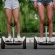 Two Sexy Young Girls Riding on Segway in Short Shorts Holding Hands and Laughing on a Sunny Day in - VideoHive Item for Sale