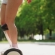 Close - Up of Women's Slender Sexy Legs in Short on White Segway Motor-wheel - VideoHive Item for Sale