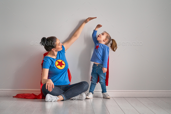 Mother is measuring growth of child - Stock Photo - Images