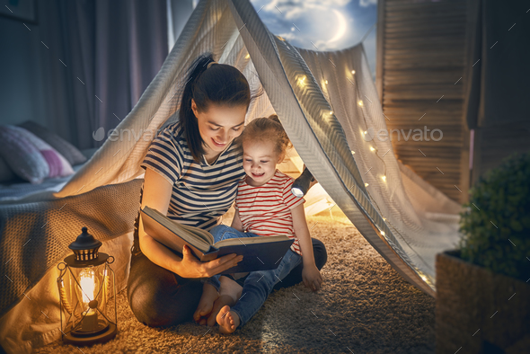 Mom and child reading book - Stock Photo - Images
