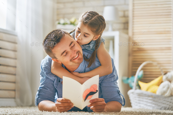 daughter congratulating dad - Stock Photo - Images