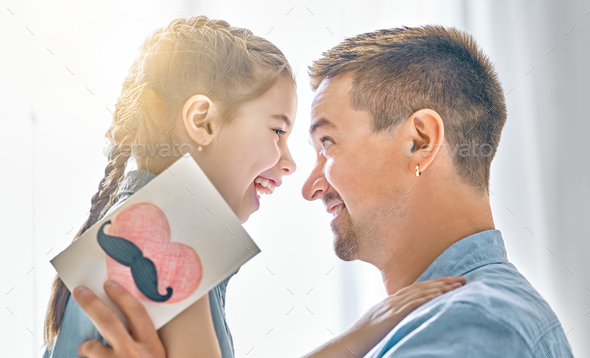 daughter congratulates dad - Stock Photo - Images