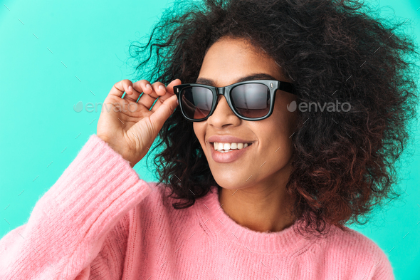 Multicolor image of american woman 20s with afro hairstyle smili - Stock Photo - Images