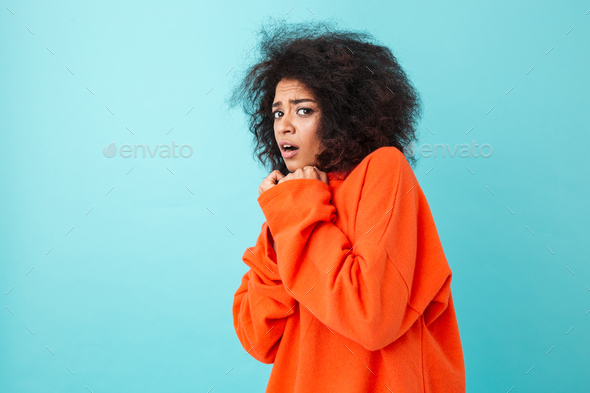 Colorful image closeup of scared woman in red shirt posing on ca - Stock Photo - Images