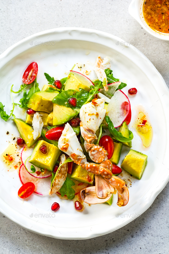 Crab with Avocado, Rocket and Pomegranate Salad by Lime and Chili Vinaigrette - Stock Photo - Images