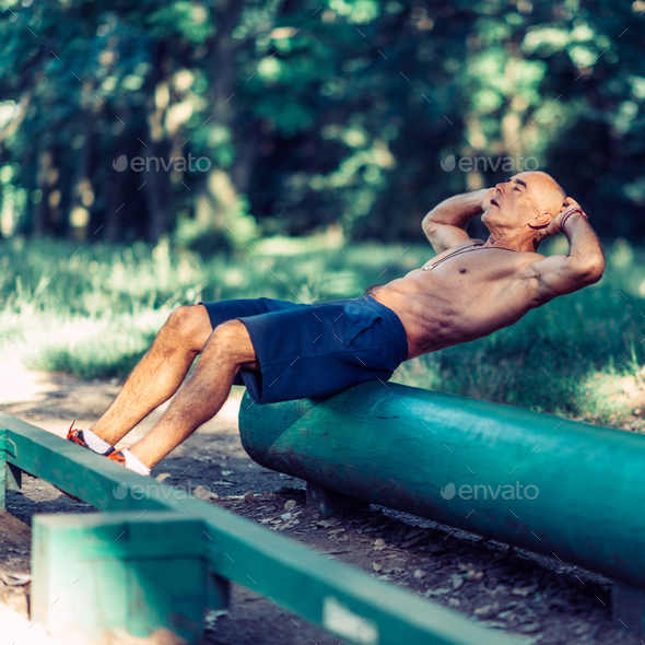 Senior man exercising outdoors - Stock Photo - Images