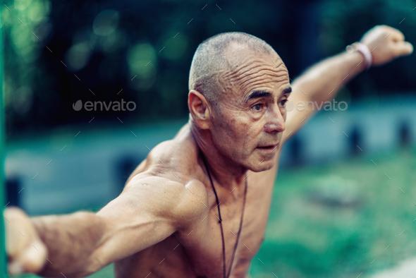 Senior man exercising outdoors - Stock Photo - Images