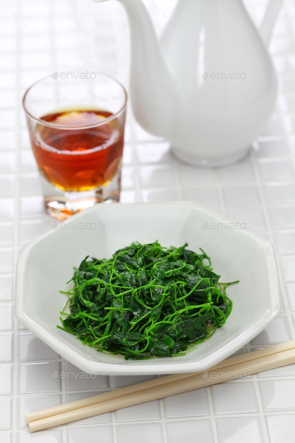 chinese white wine stir fried with toothed bur clover - Stock Photo - Images