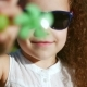 Portrait of a Happy Cute Little Girl Child with Curly Hair and Red Sunglasses Looking Into the - VideoHive Item for Sale